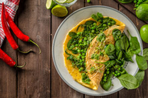 Bio healthy food, egg omelette with herbs, microgreens and peas